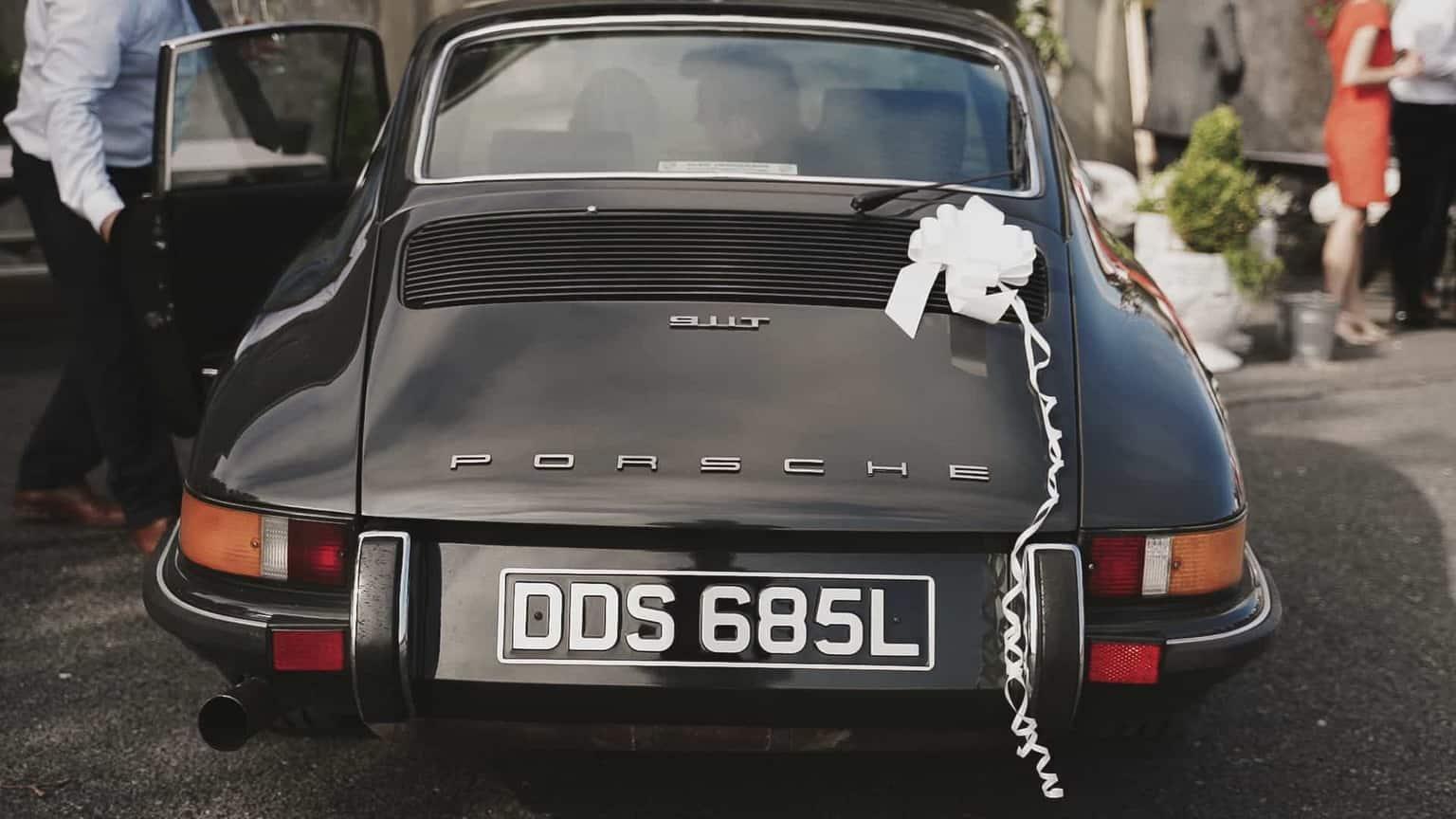 Porsche as a wedding car with ribbons.