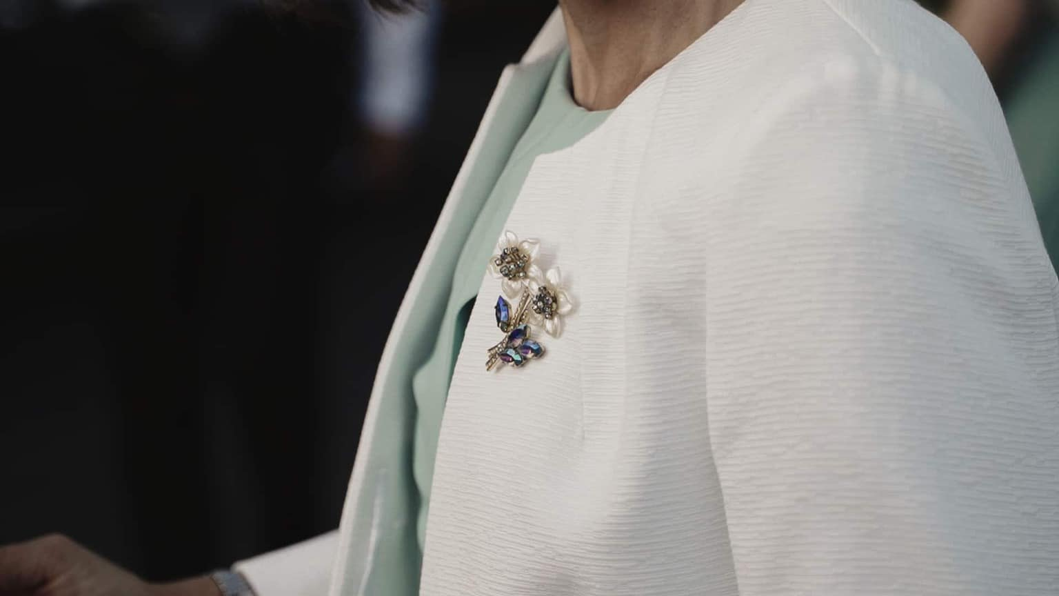 wedding brooch on Mather coat