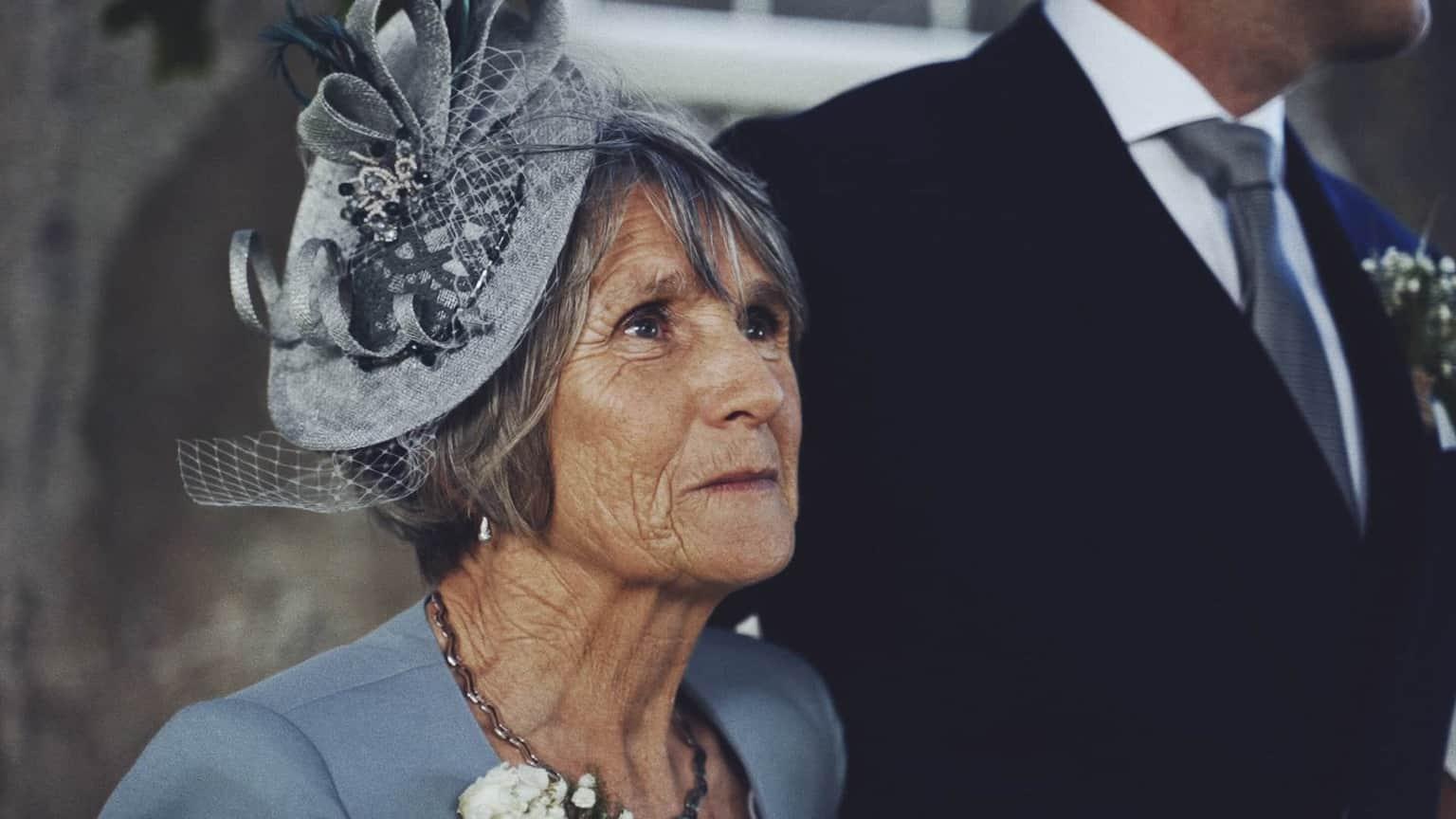 Mom of bride looking in future.