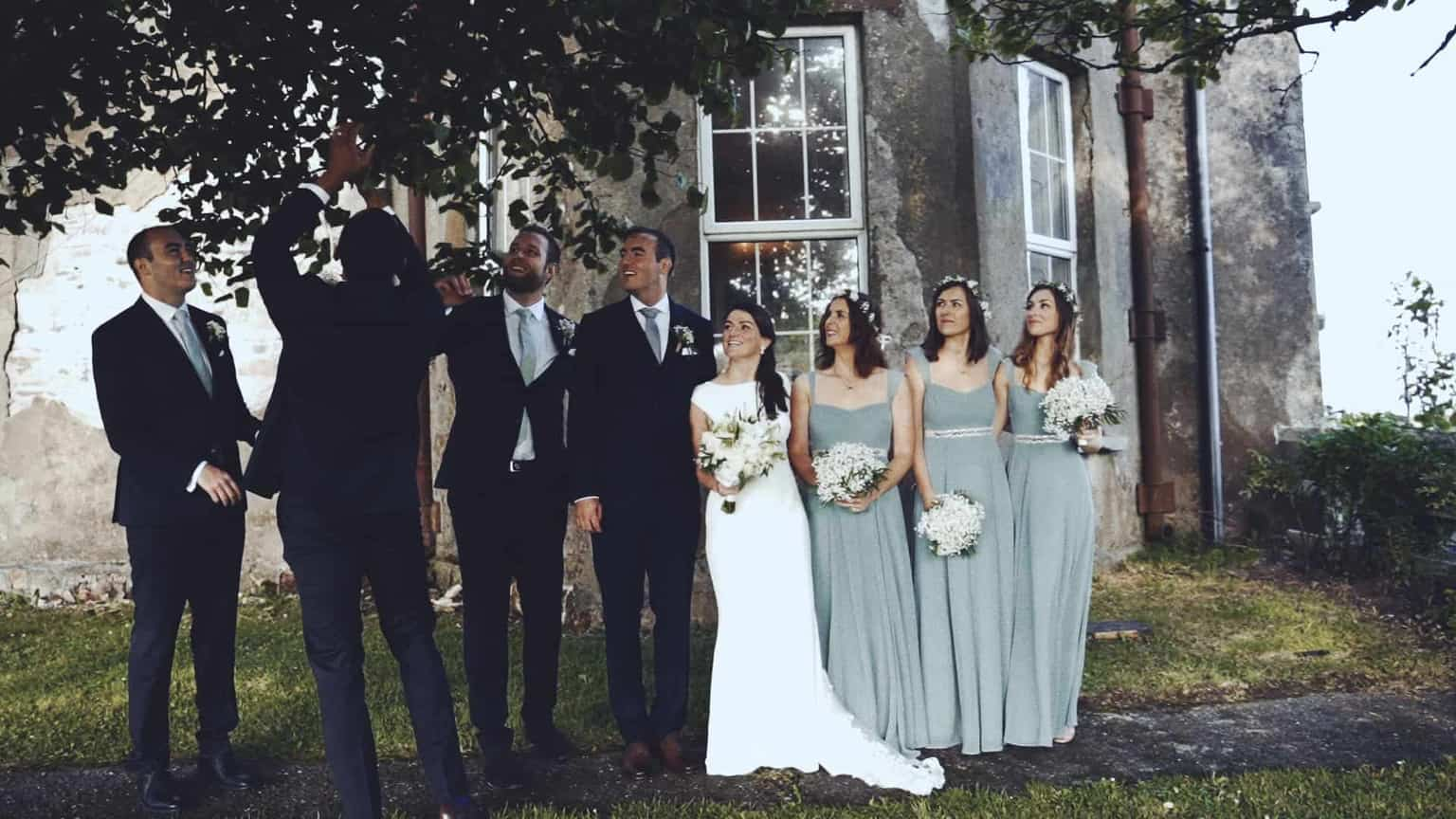 Brides maids and grooms mans on family picture.