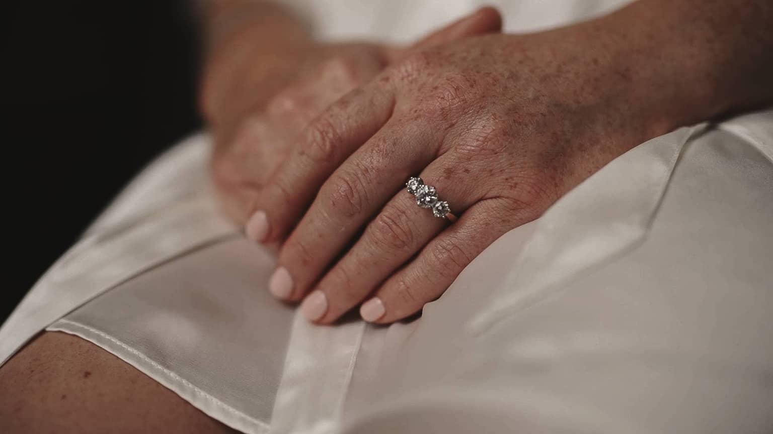 Detailed engagement ring on finger