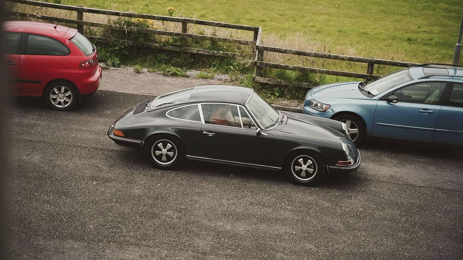 Porsche arriving and groom practicing drive.