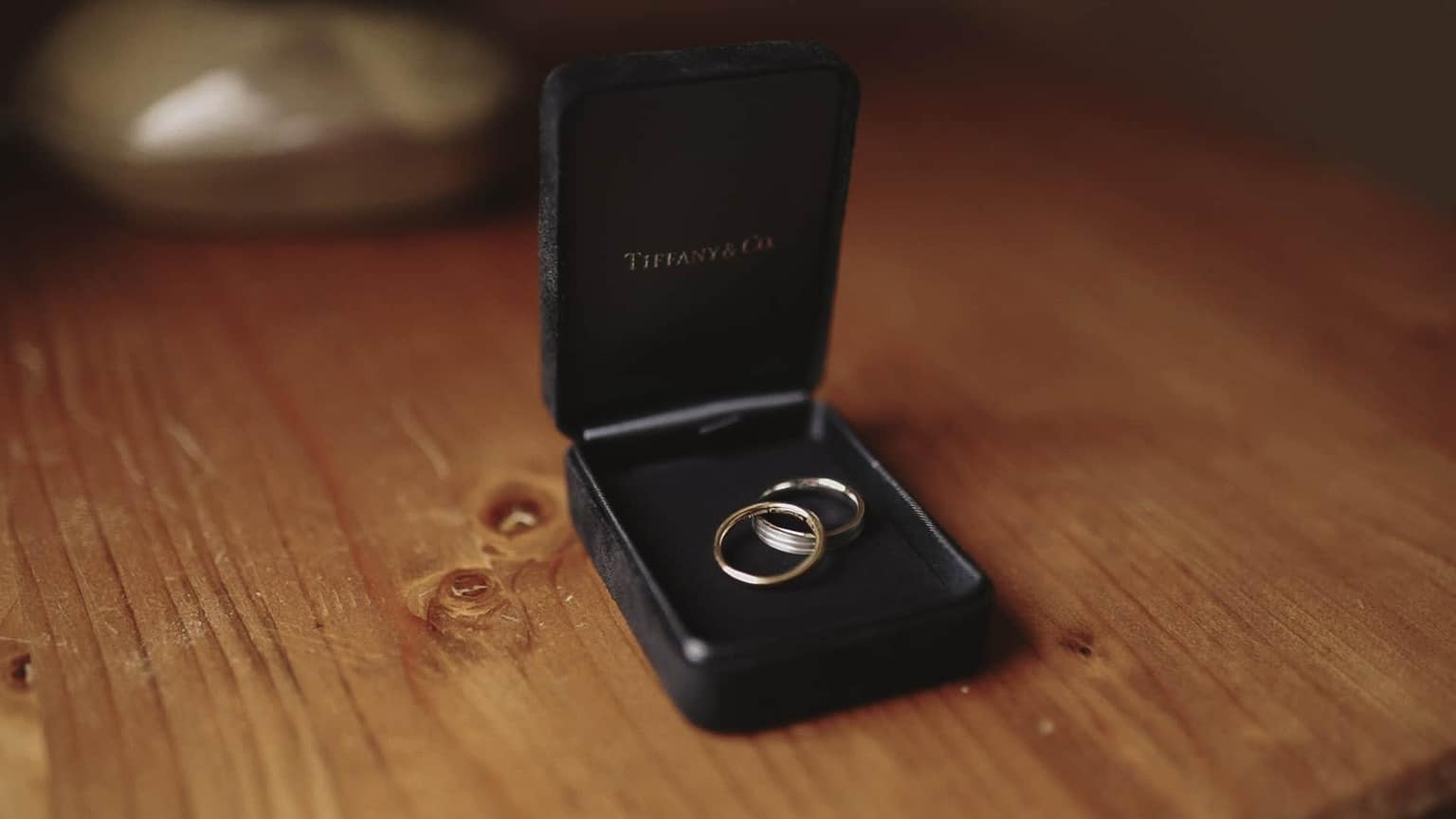 wedding rings presented in box.