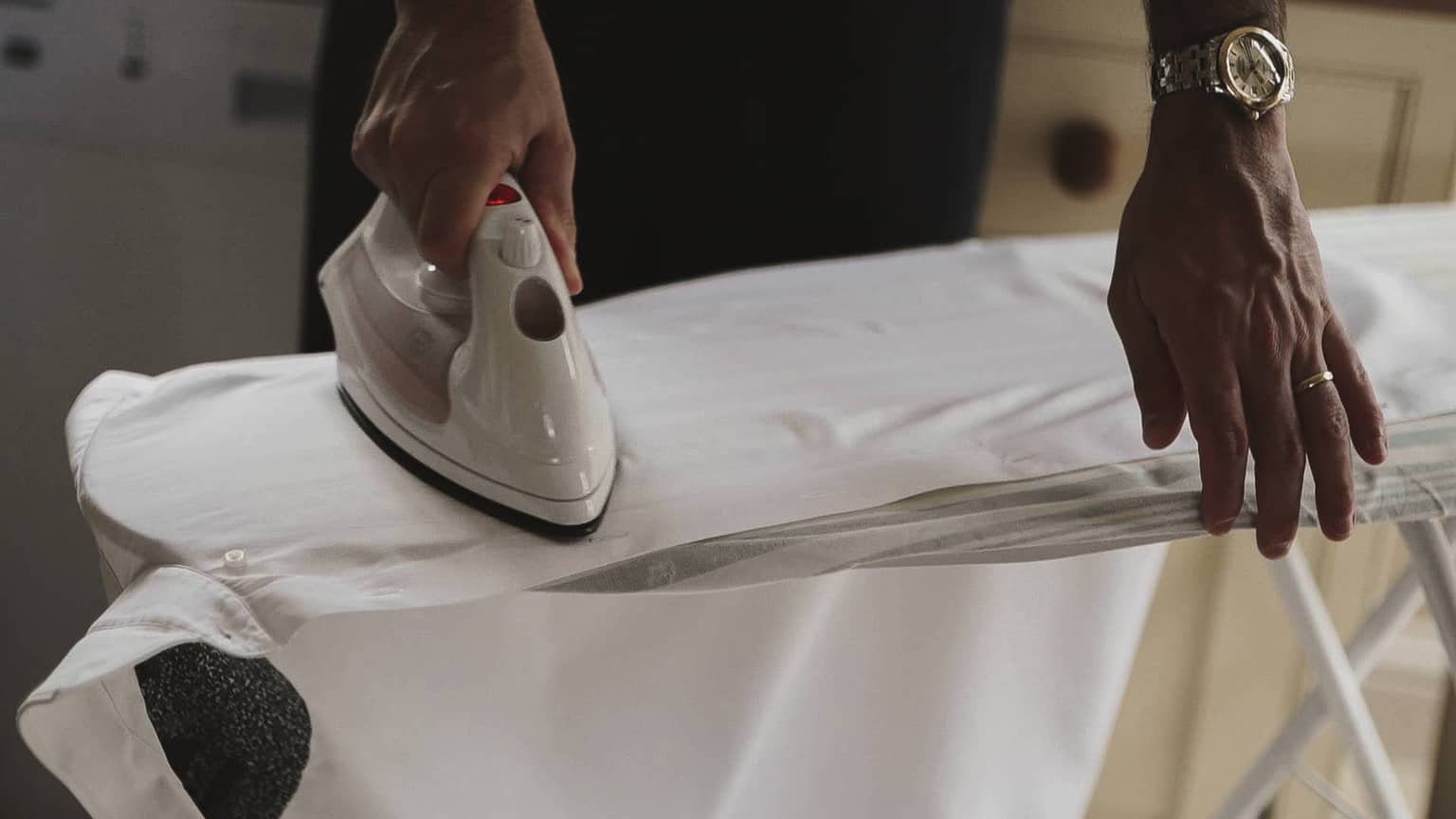 Ironing white shirt.