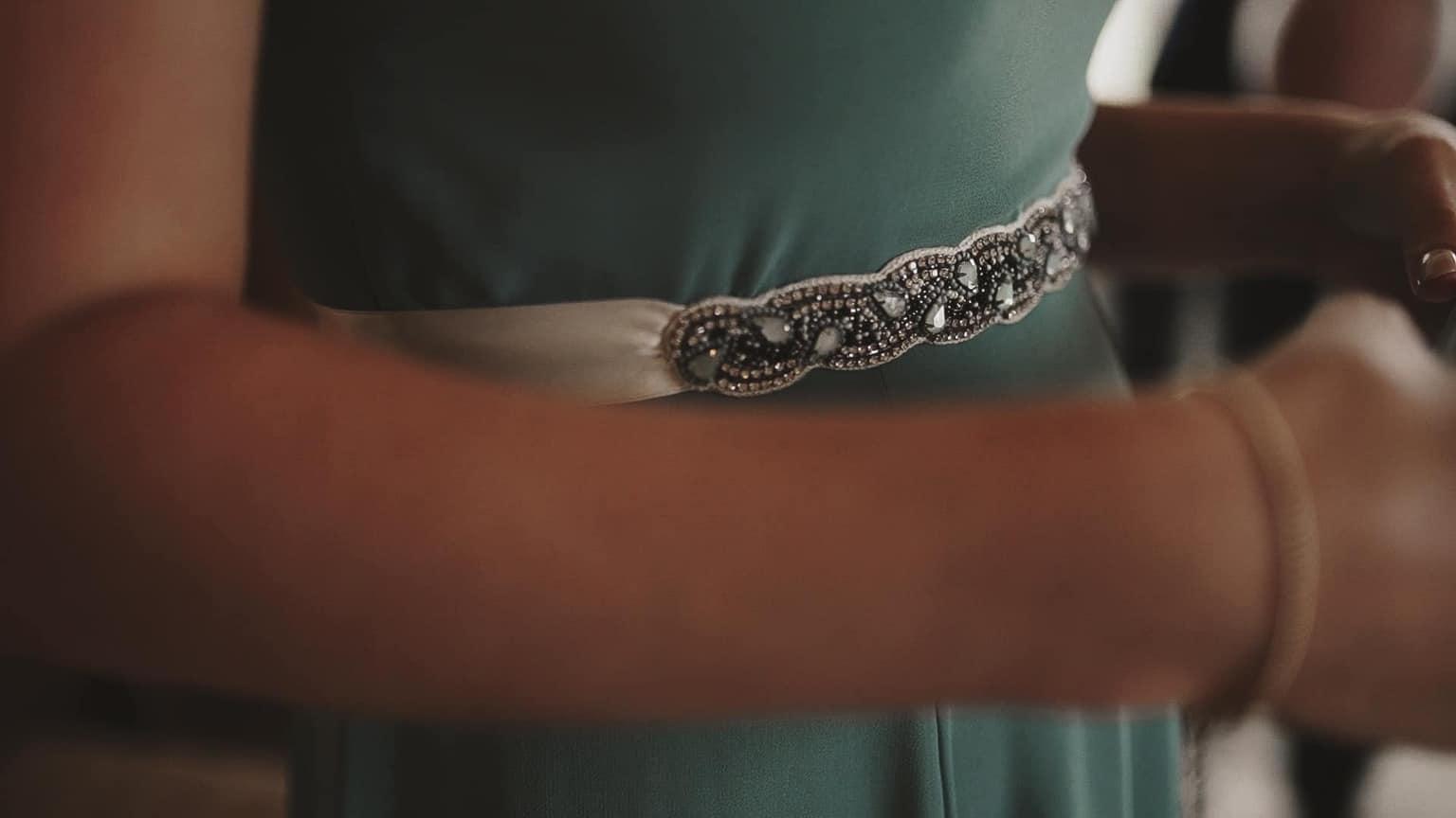 Shining belt on dress.
