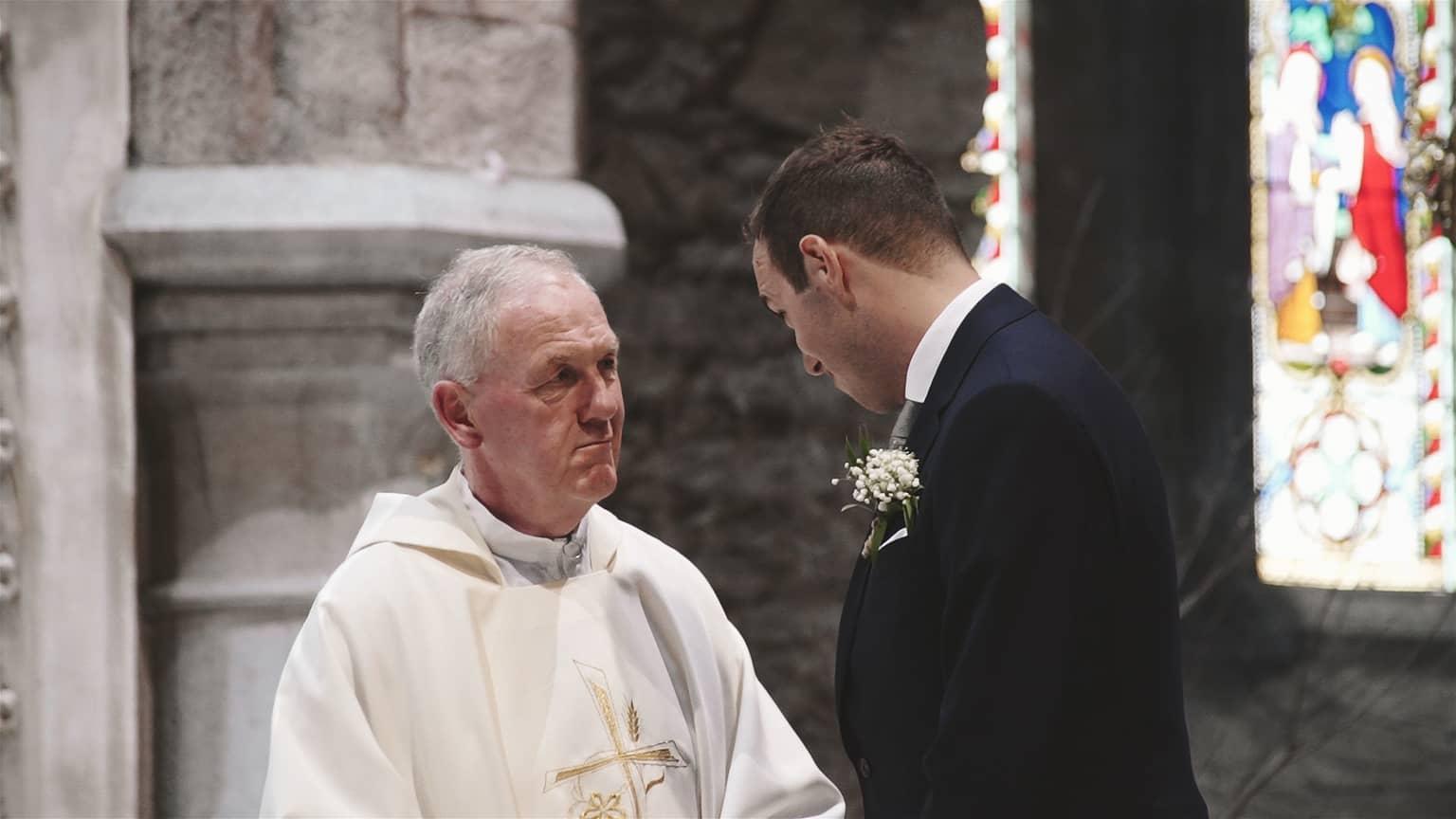 Priest is making final word to groom.