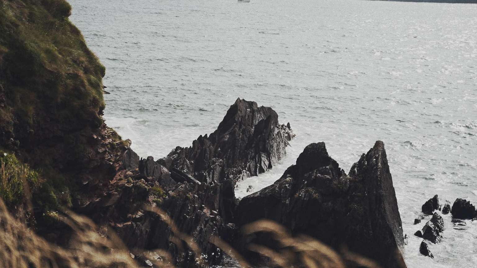 View with ocean and waves crashing rocks