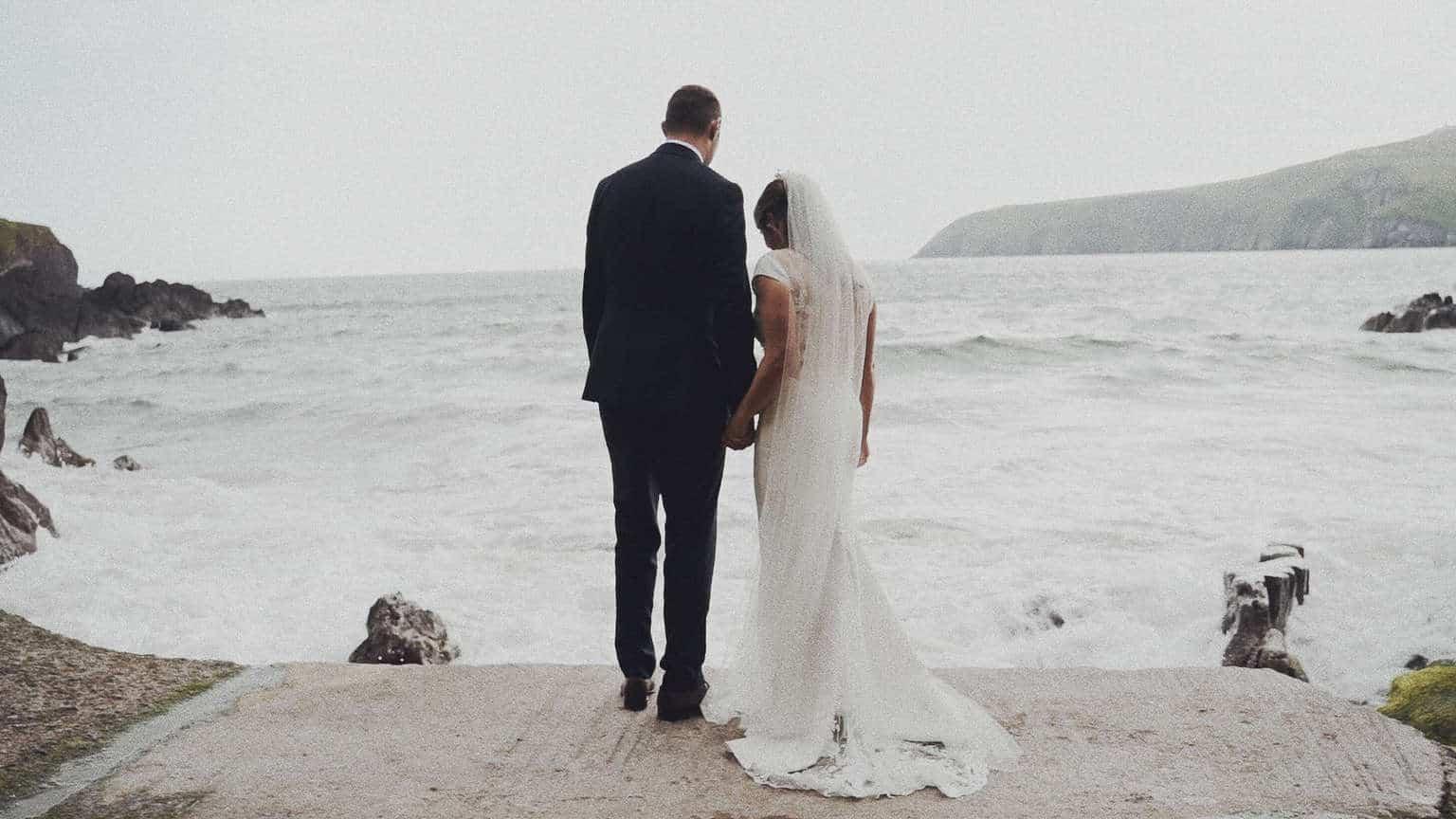 Wedding couple is watching on Irish ocean