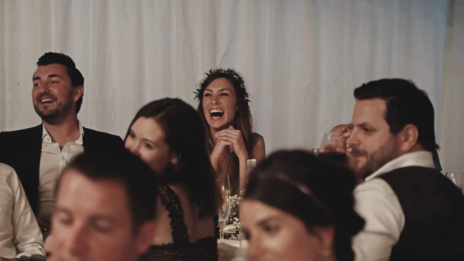 Brides maid smile during wedding speech.
