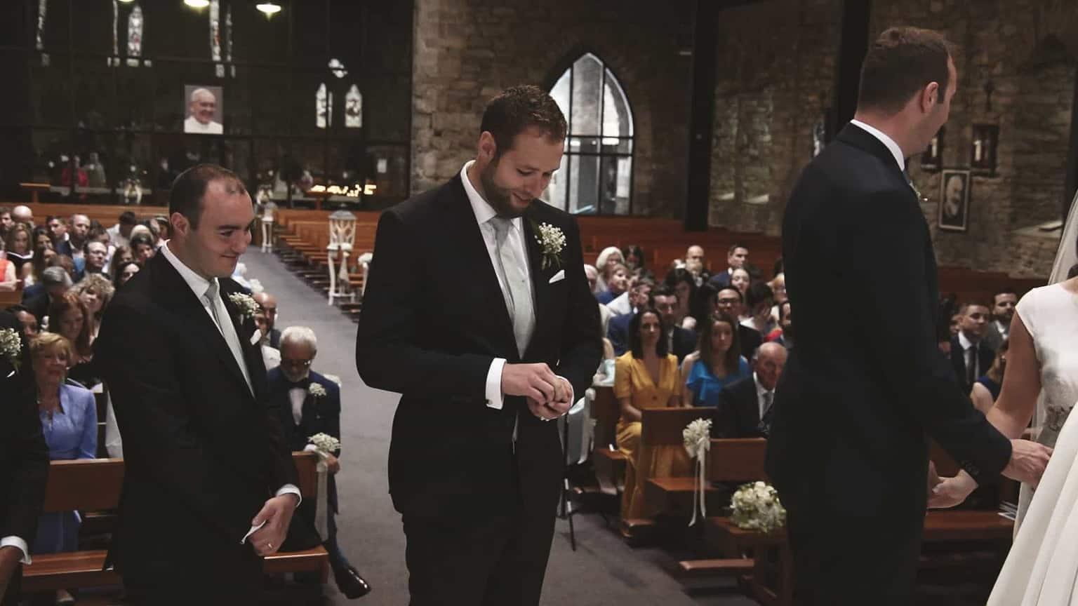 Grooms man looking for wedding rings.