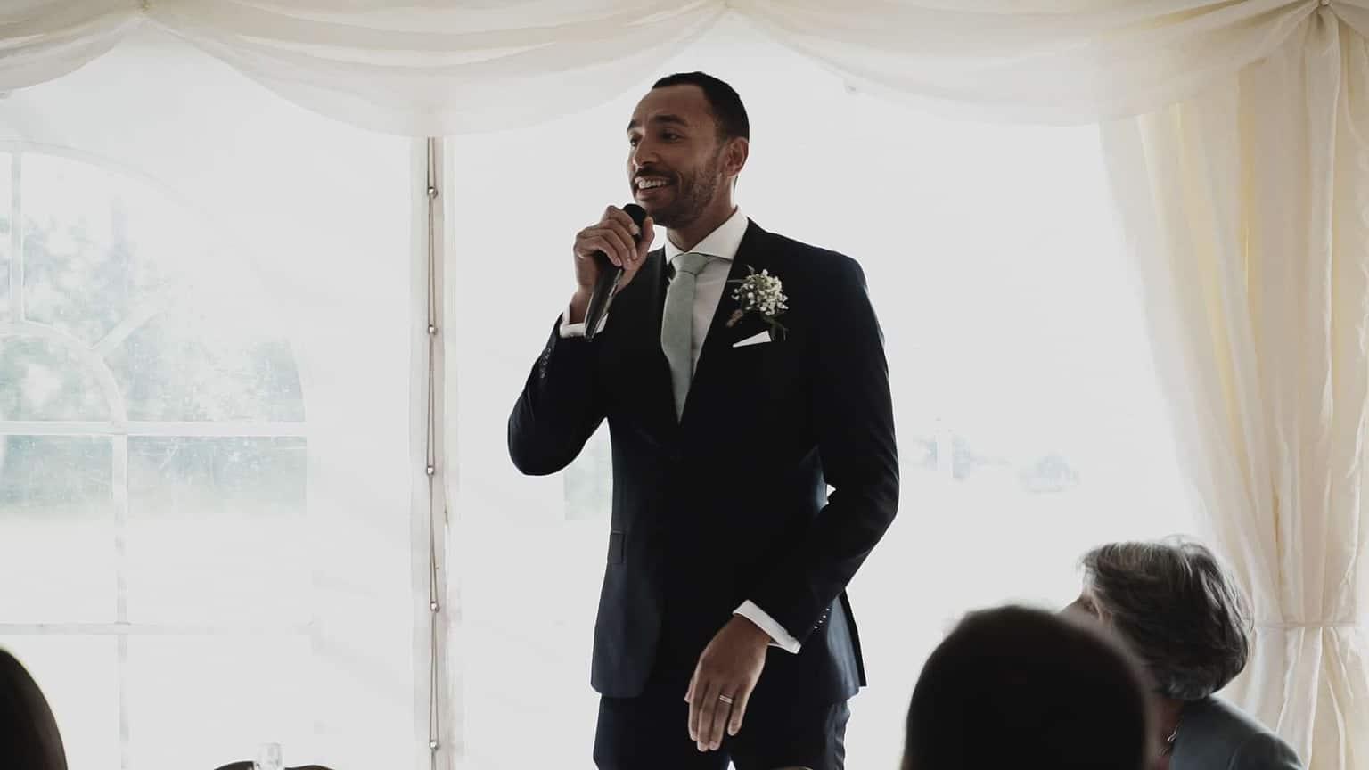 Grooms man introducing bride and groom
