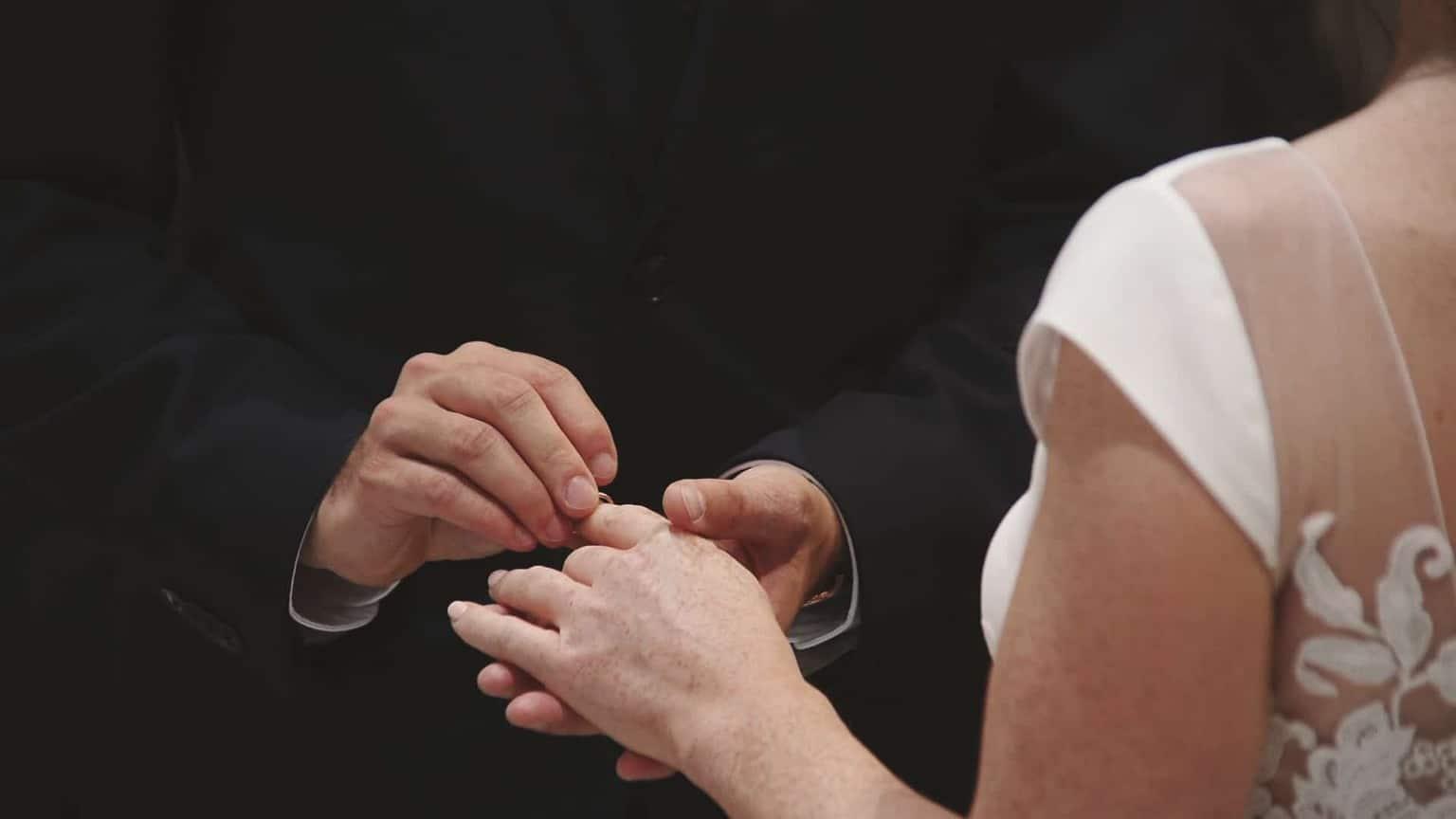 Close look at exchanging wedding ring.