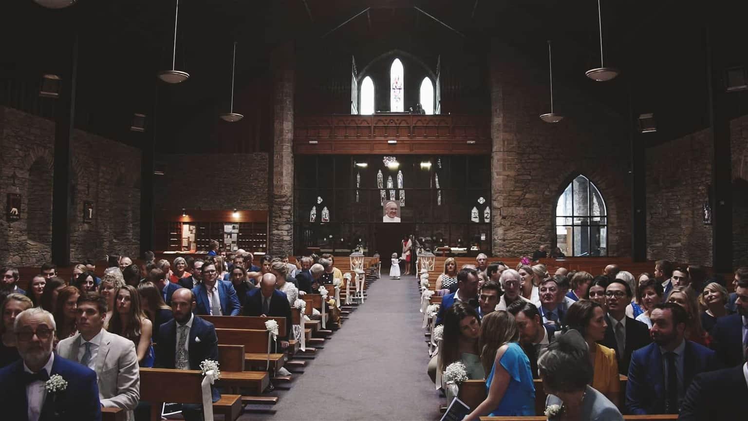 Bride is entrancing to church.