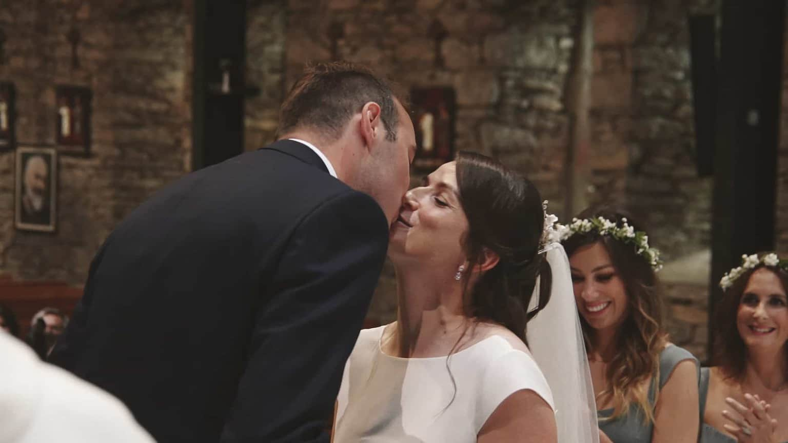 First kiss after vows.