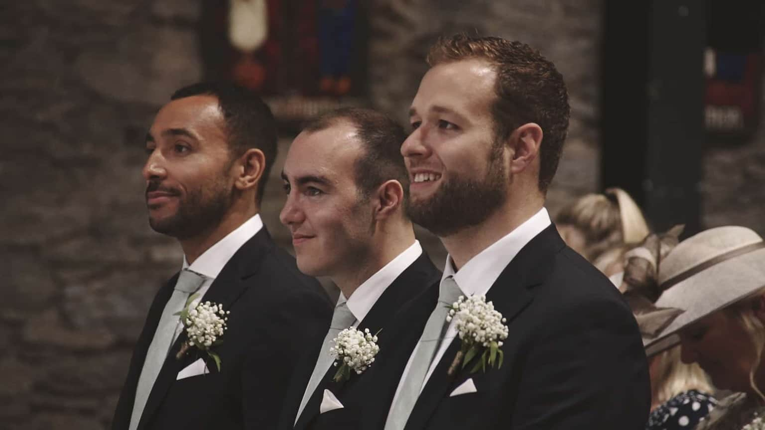 Grooms mans smiling when looking at newly marriage