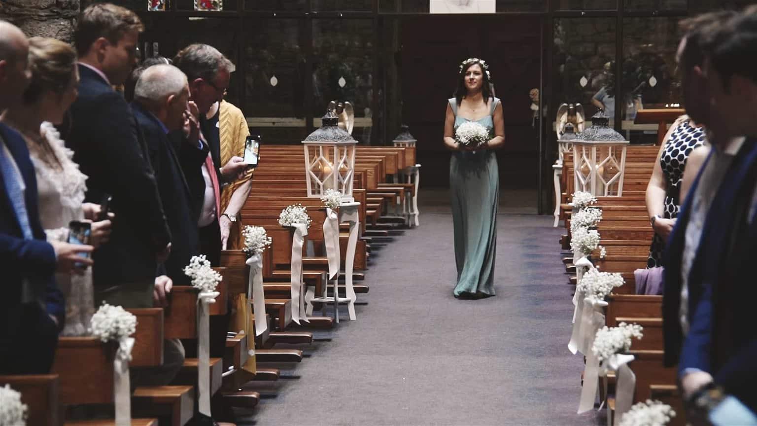 Bridesmaid entrancing church.