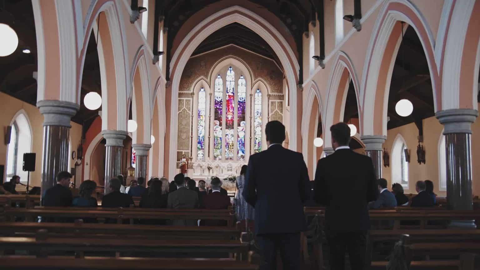 Saint Michael's and Saint John's Catholic Church wedding guest arriving