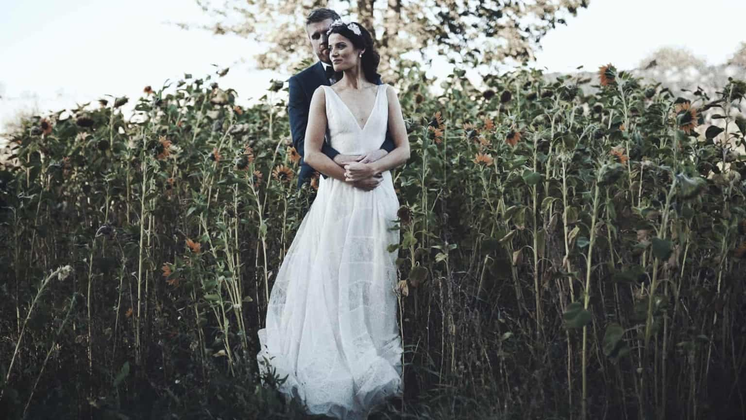 amazing picture of wedding couple and sunflowers at Cloughjordan