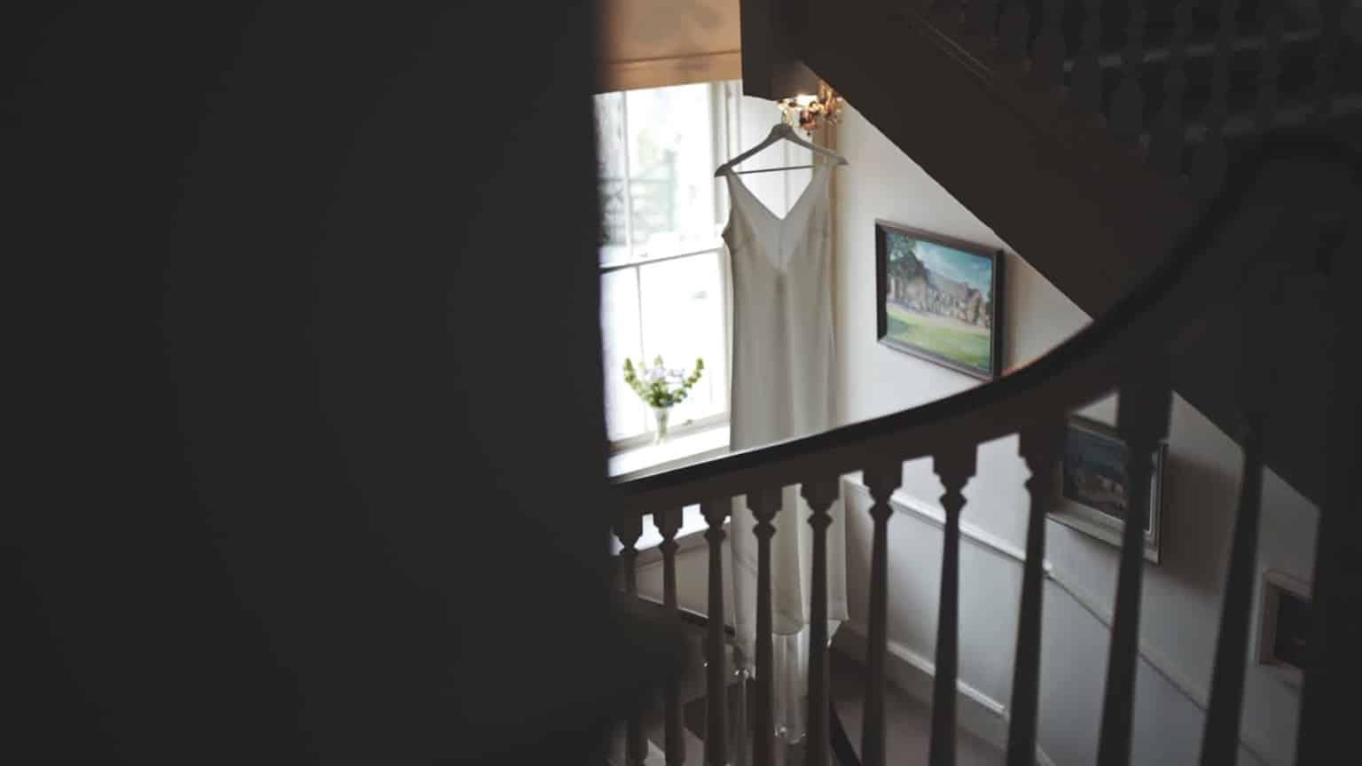 wedding dress is hanging in main housecorridor