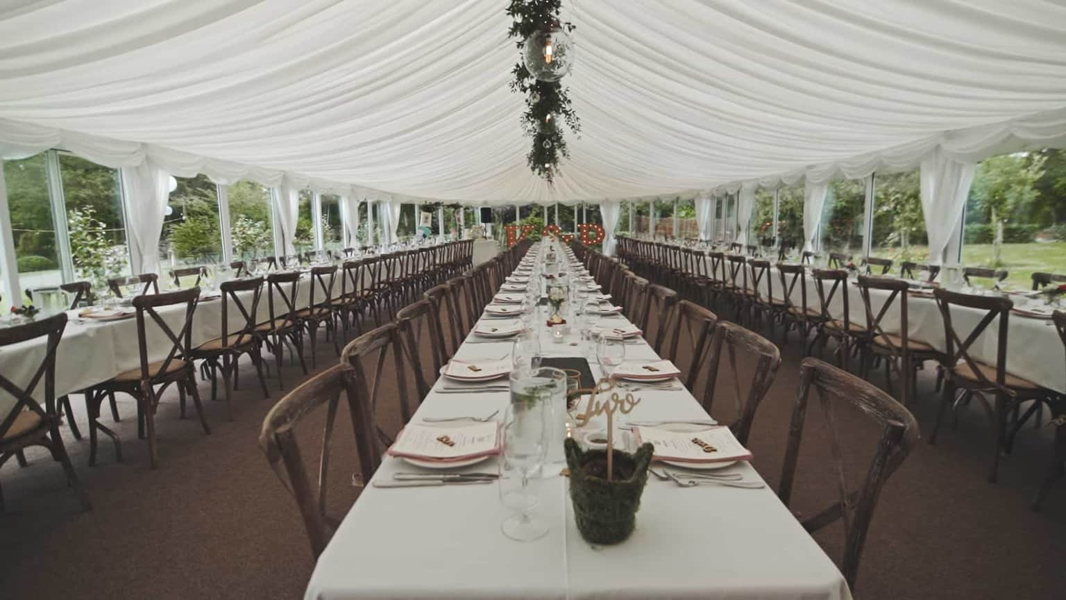 Marque view at wedding decorations before meal