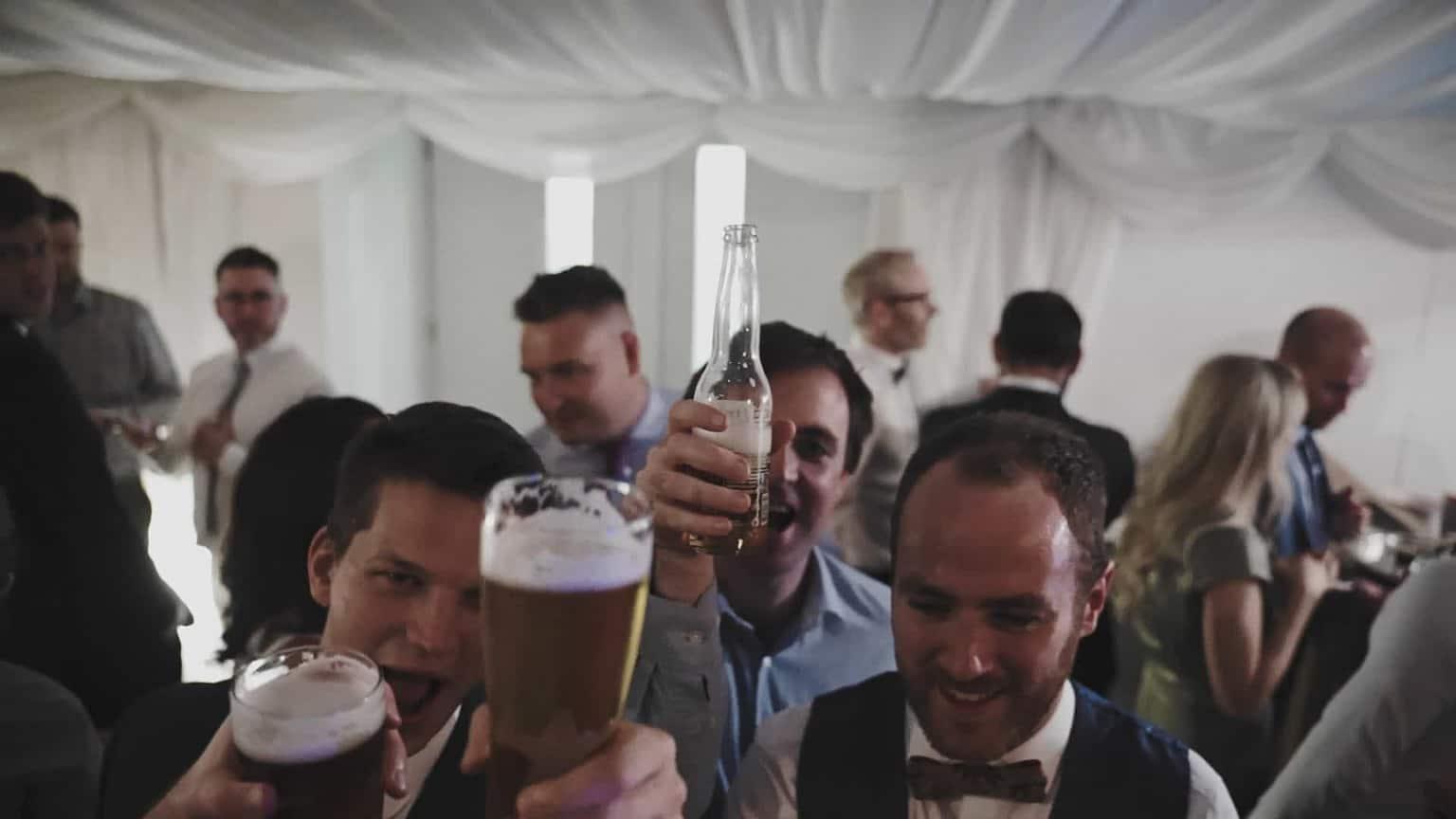 laughing people drinking beers