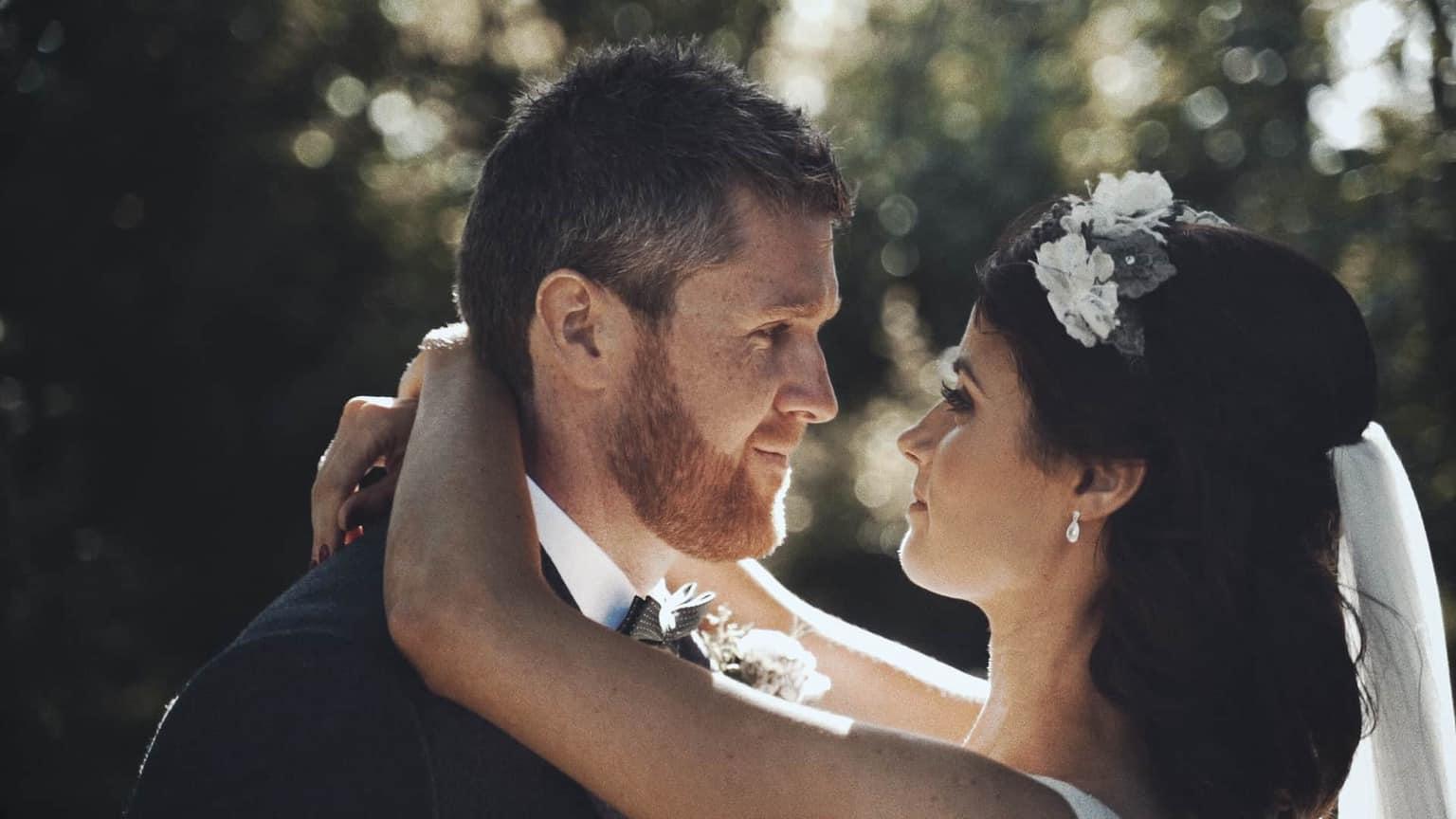 Bride and groom looking deeply in eyes