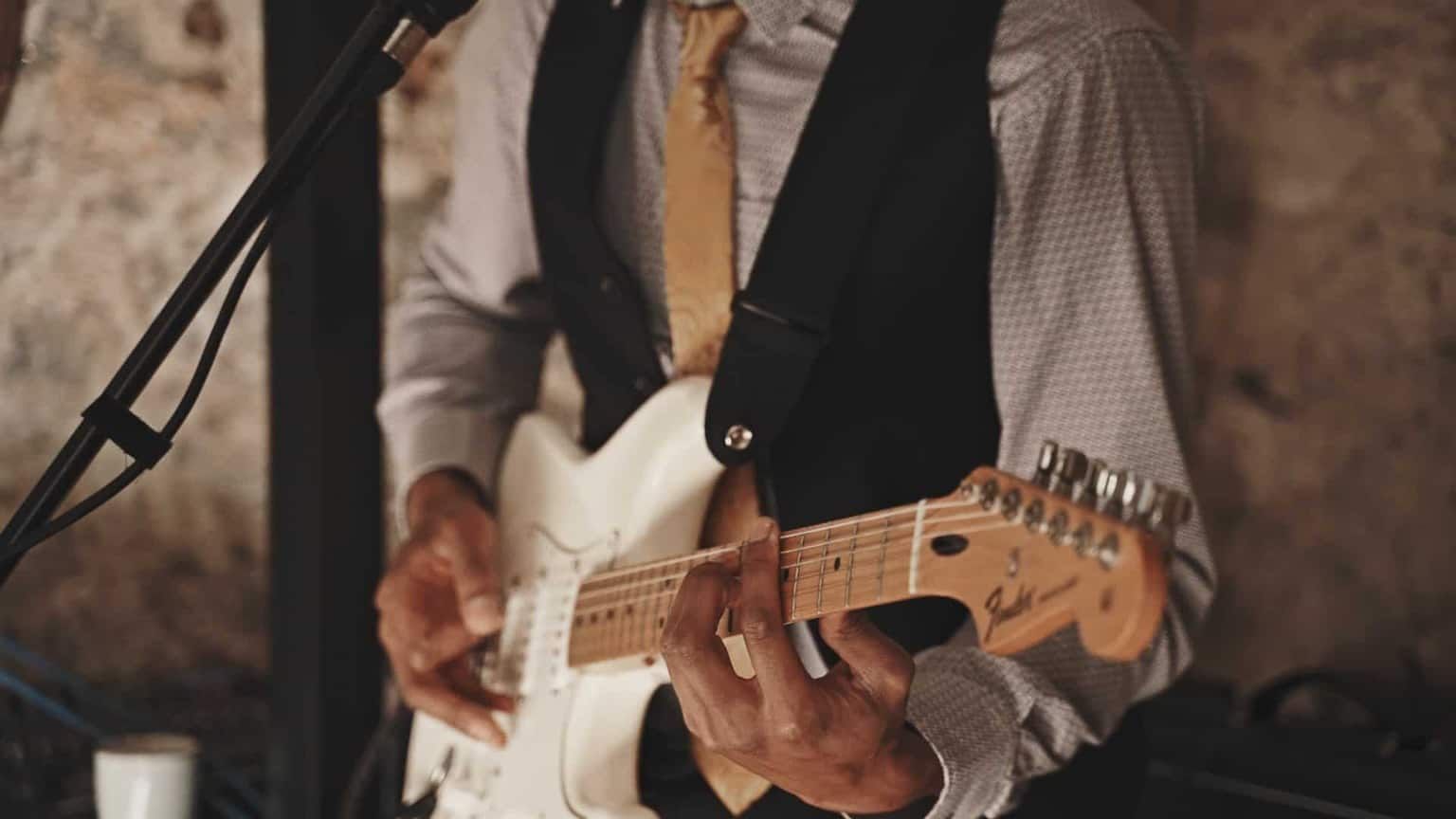 guitarist playing for wedding guest