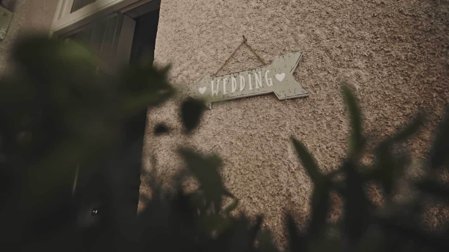 wedding arrow showing road to marquee