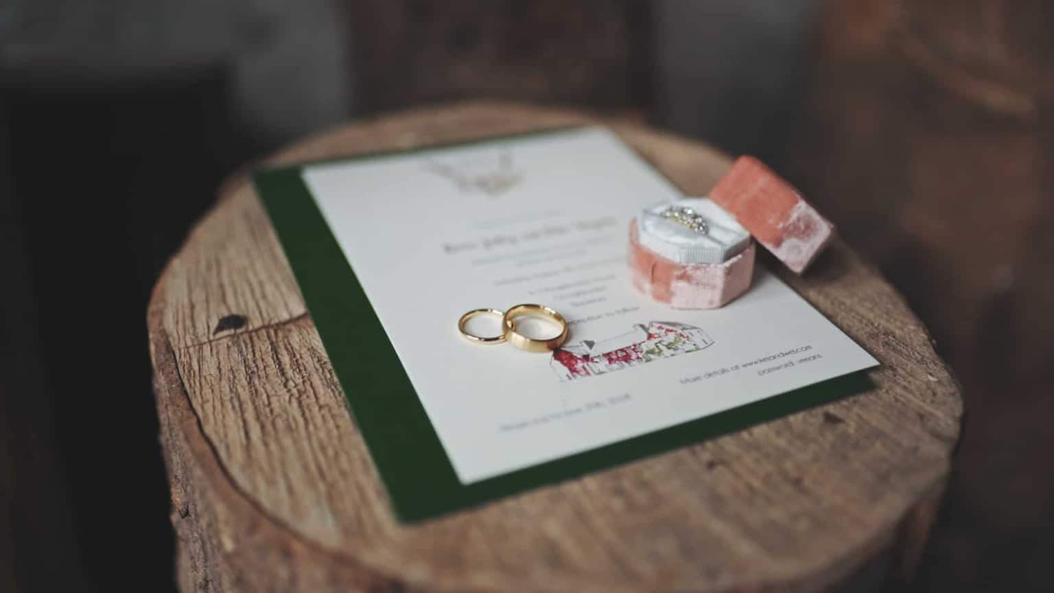 wedding rings and green form