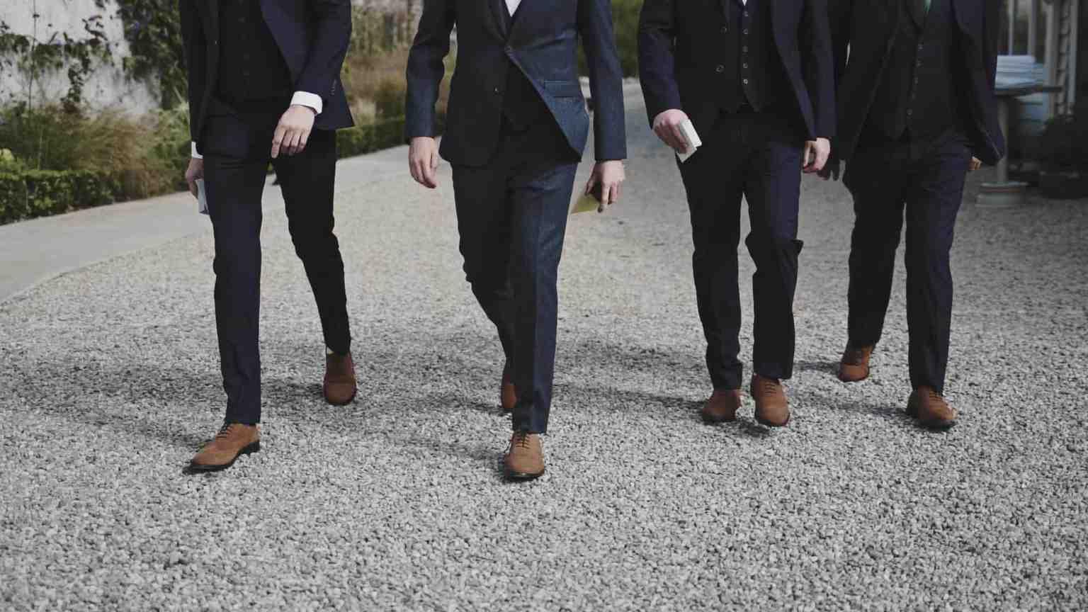 Groom with best men walking to ceremony