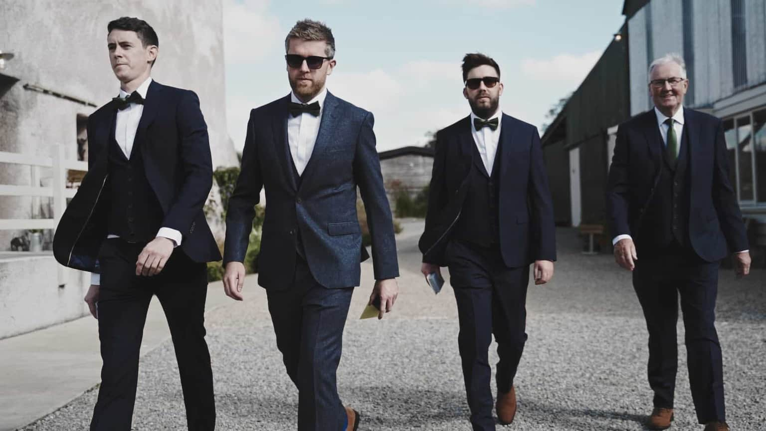 groom with best men walking from cowshed