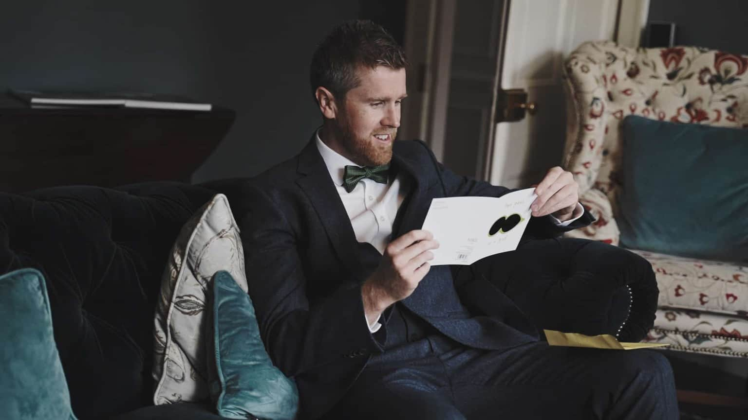 Groom is reading letter from bride