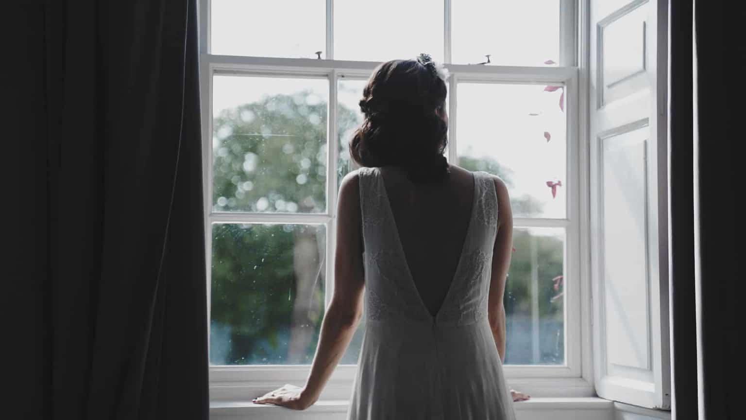 Bride looking out window in cloughjordan house