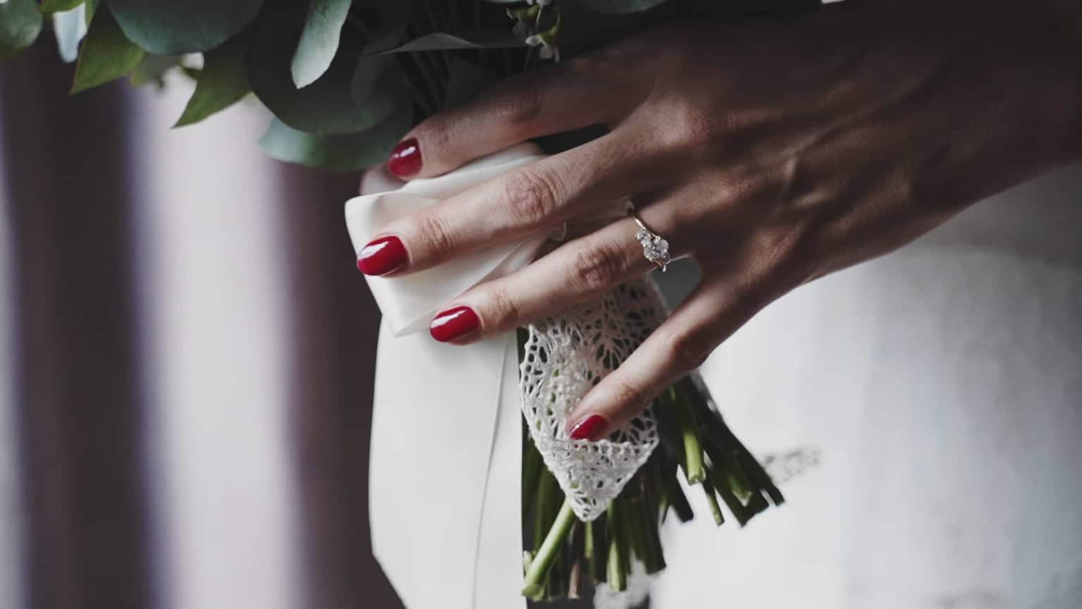 engagement ring on bride when holding bouquet