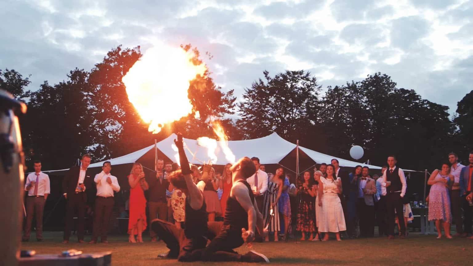 wedding guest admiring fire show