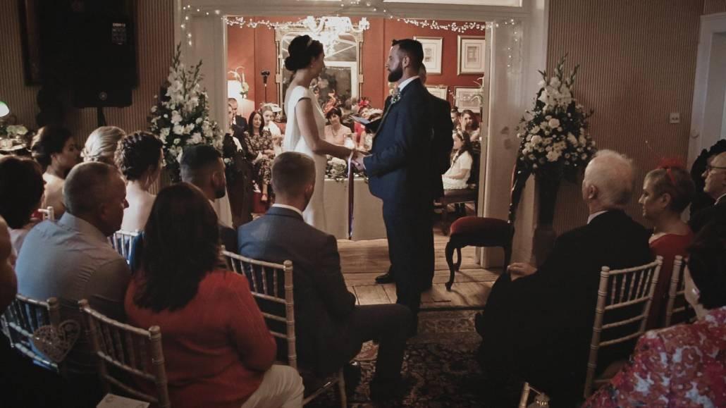 wedding ceremony inside of ashley park house.