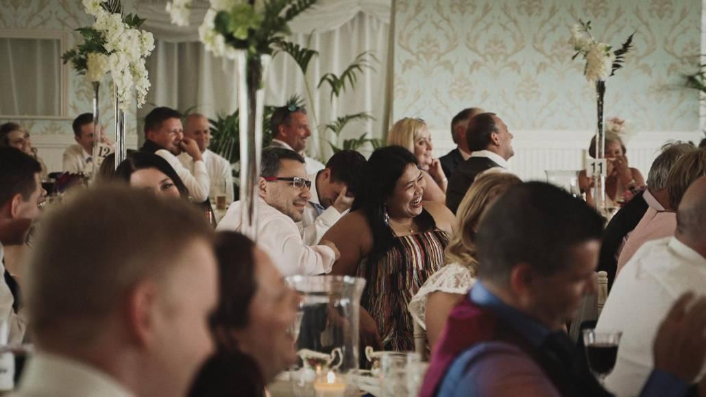 Wedding guest listening speeches