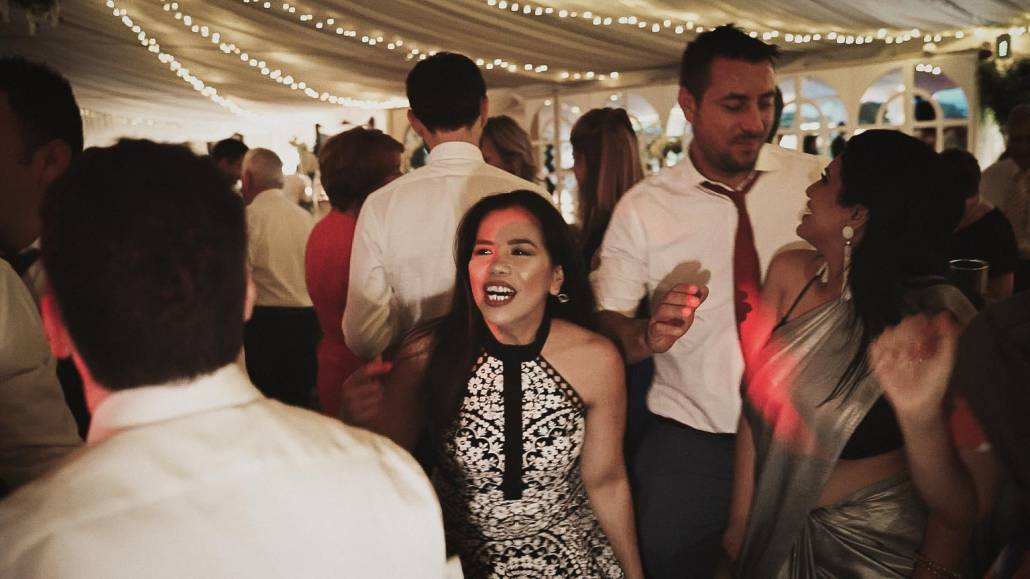 Wedding guest dancing on the dance floor with smiling faces