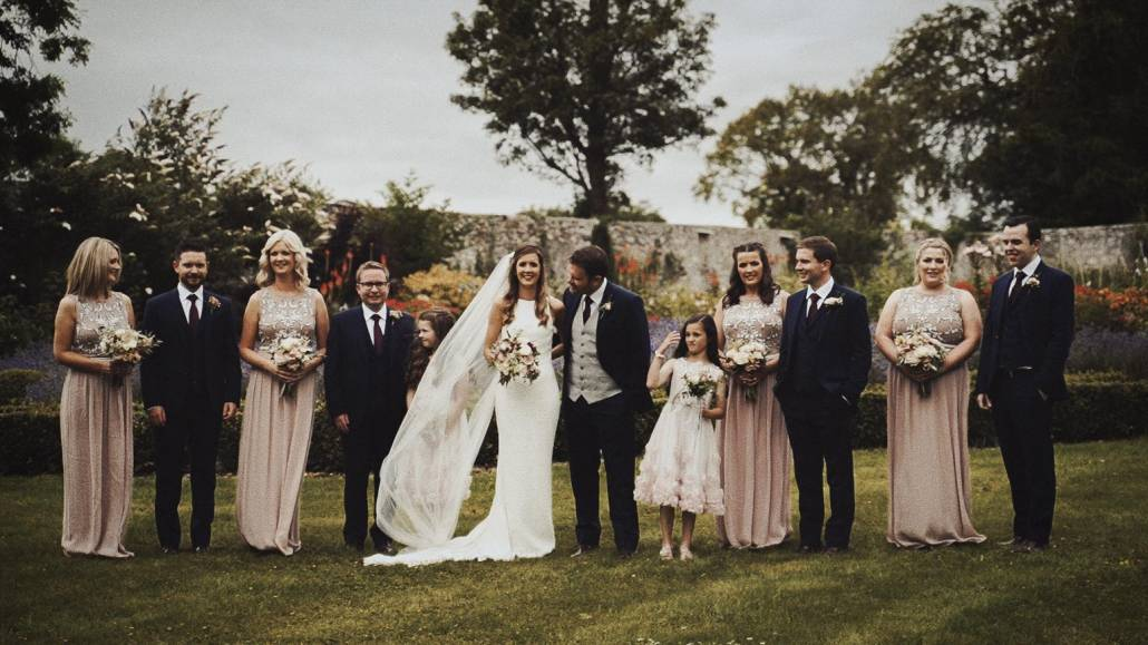bridesmaid and best mans taking pictures