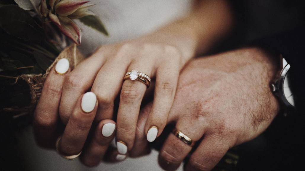 Look at wedding rings on hands