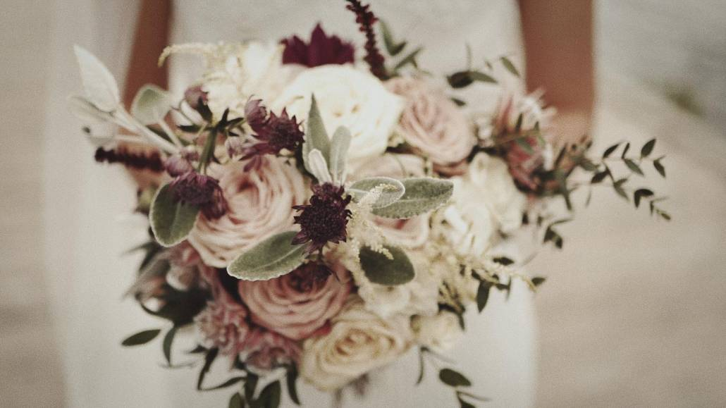Bride is holding wedding bouquet