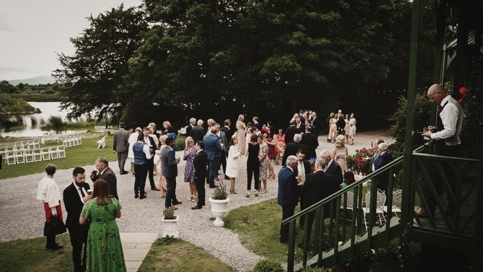 Wedding guest talking and drinking happily