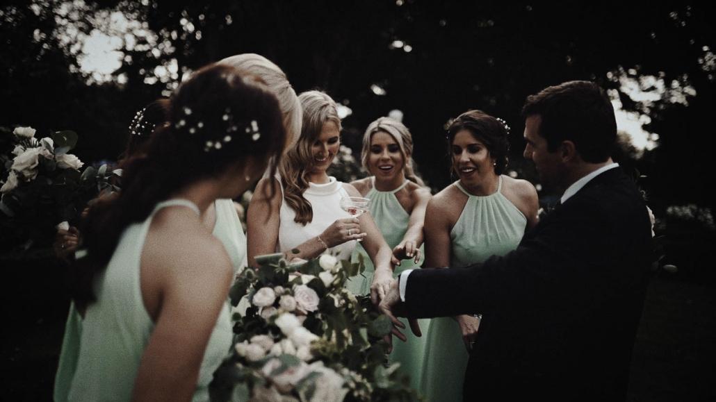 Bridesmaids admiring wedding ring on bride hand