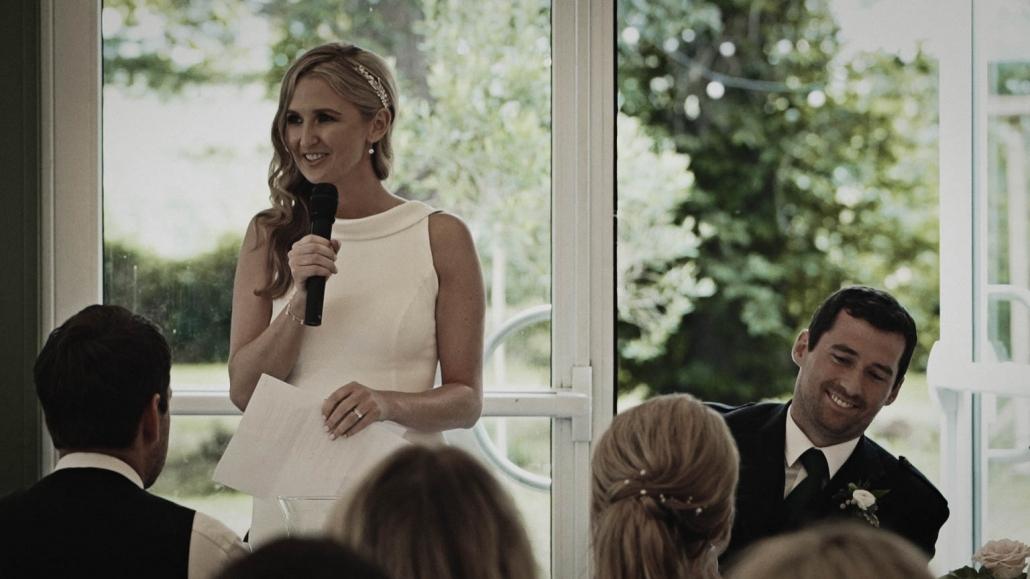 bride speaking to guest