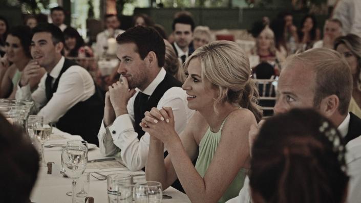 bridesmaid is listening the speech