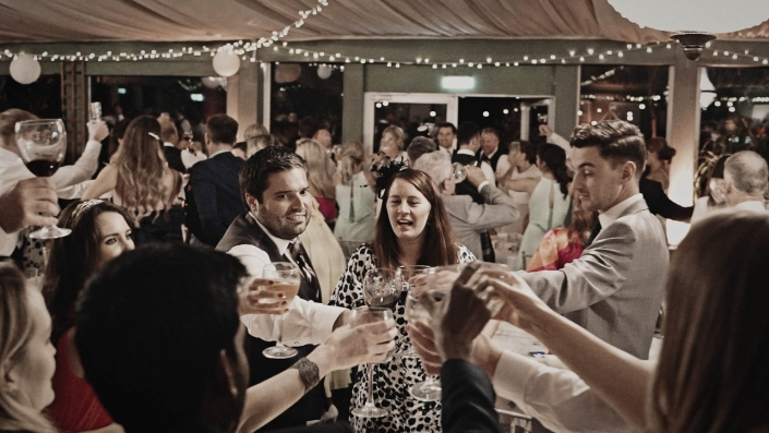wedding toast with happy people