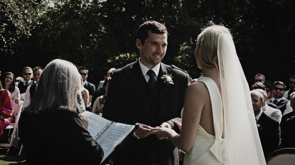 Groom is putting wedding rings on bride finger