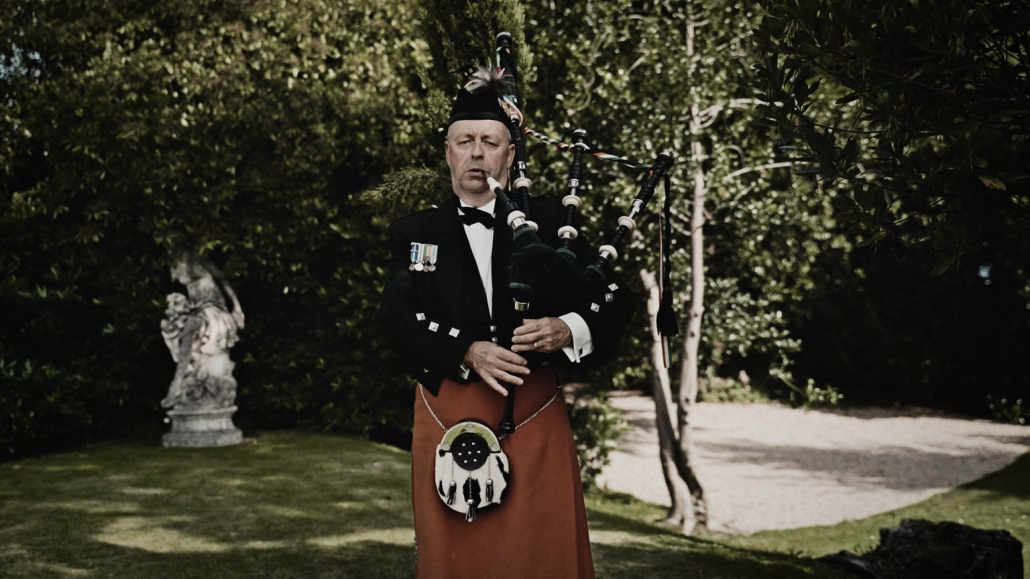 Scottish man playing on bagpipe in Tinakilly House