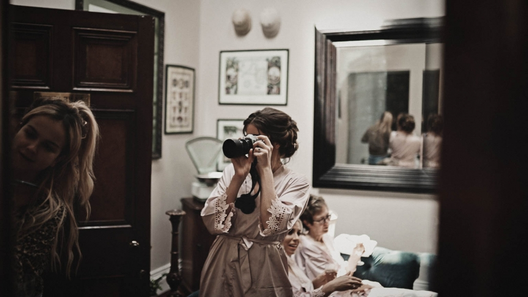 bridesmaid is making wedding photo
