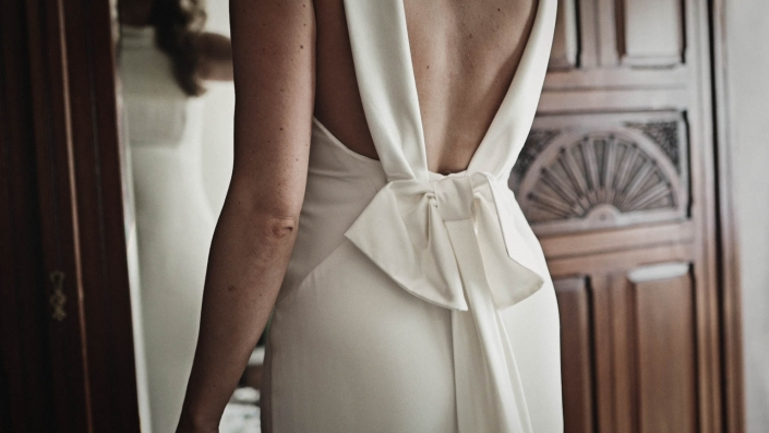 Ribbon placed on back of wedding dress